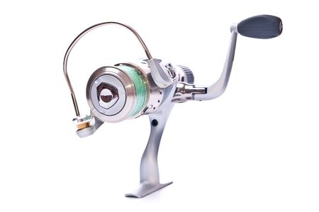 Steel fishing reel on white background isolated photo