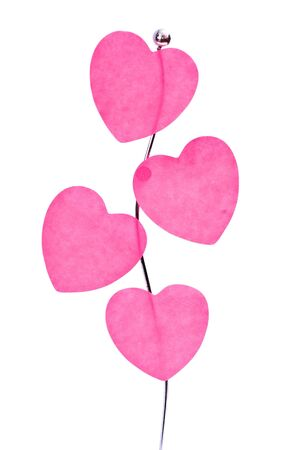 Pink valentine's hearts on a holder isolated on white photo