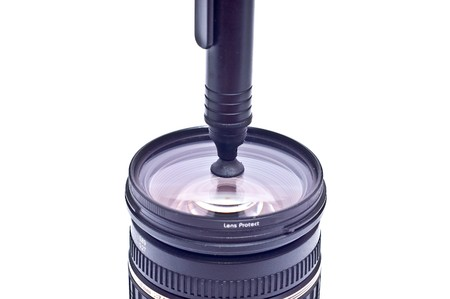 neccessary: a camera lens with lens cleaning brush pen