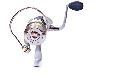 fishing reel isolated on white background photo