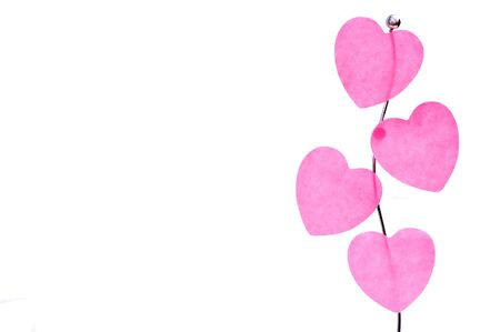 Pink valentine�s hearts on a holder isolated on white Stock Photo - 7368312