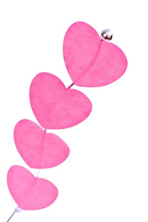 Pink valentine's hearts on a holder isolated on white Stock Photo - 7368511