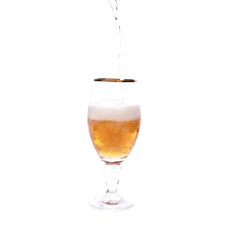 Beer poured into glass. Isolated on white Stock Photo - 7636771