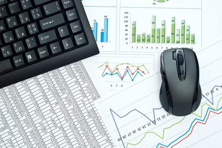 Black keyboard and mouse on a stock chart. Stock Photo