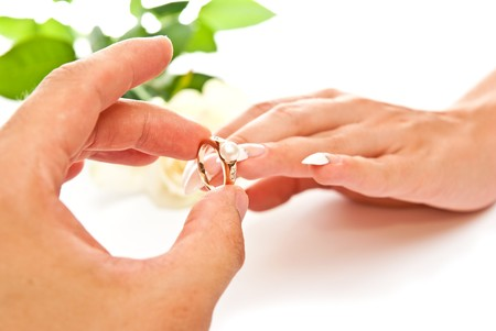 Mans and womans hands with golden ring photo
