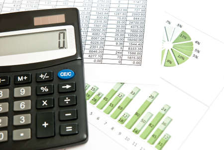 Close-up on stock market data chart and calculator. photo