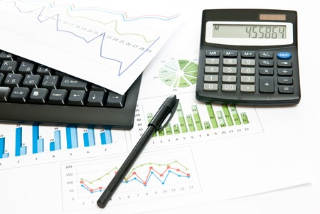 Business still-life with diagrams, pen and calculator photo