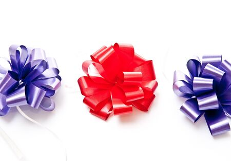 Red and blue bows on white background Stock Photo - 7680914