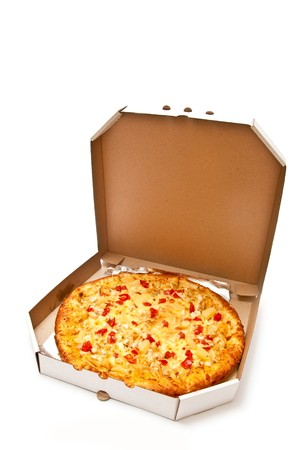 Fresh pizza in plain open box isolated on white background. Light shadow photo