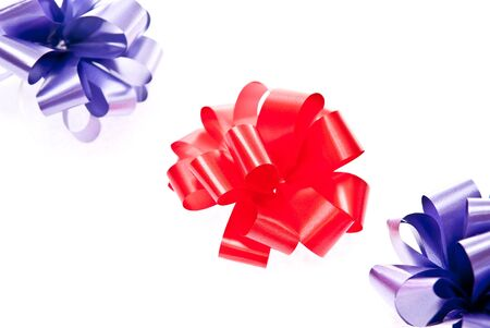 Red and blue bows on white background Stock Photo - 7680893