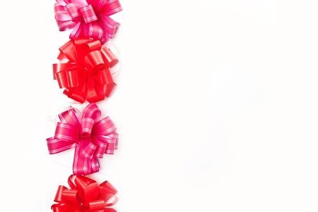 Line from red bows on white background Stock Photo - 7680862