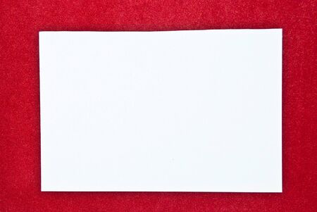 White paper blank on red background. Studio shot   photo