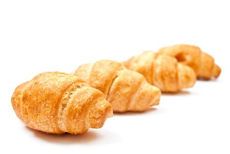 Group of croissants isolated on white background Stock Photo - 7680900