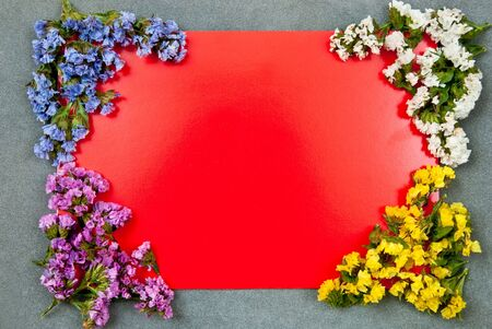 Red paper blank on grey background with flowers design  photo