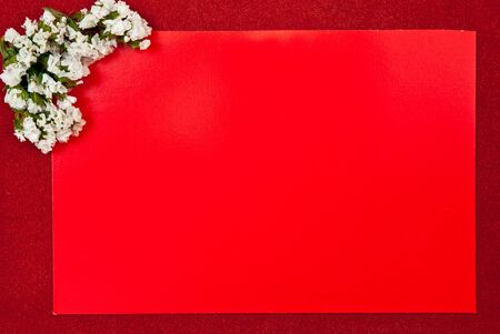 Red greeting card on red background with flowers design photo