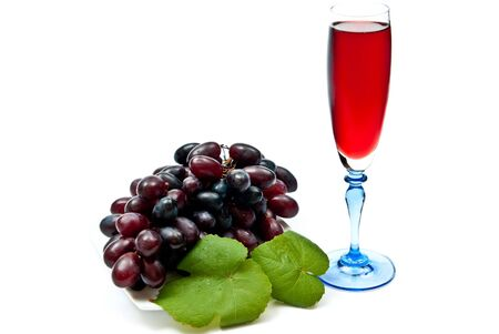 Red wine in glass with plump grapes. Isolated on white. Soft shadow photo