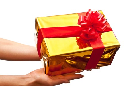 Woman's hands with a gold gift box with red bow isolated on white background Stock Photo - 7790294