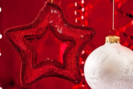Beautiful christmas star and white baubles on red background photo