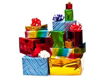 Stack of colored gift boxes with bows. Isolated on white photo