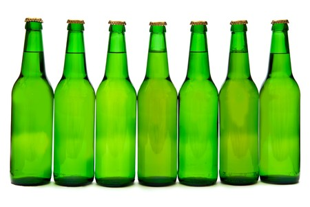 Row from  seven beer bottles. Isolated on white background photo