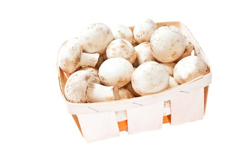 Raw mushrooms in box on white background photo