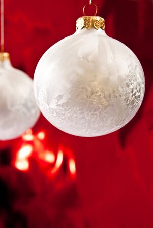 Christmas baubles on red background. studio shot photo
