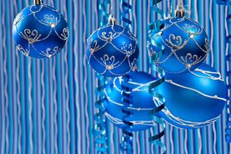 Christmas decoration from blue balls on blue background  photo