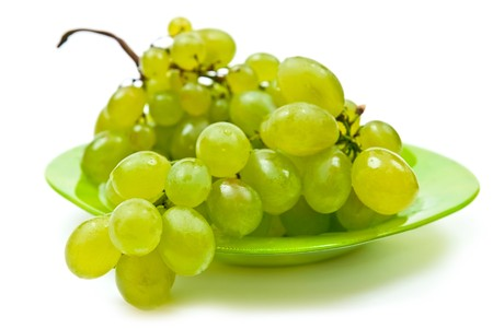 Green grape on plate isolated on white background photo