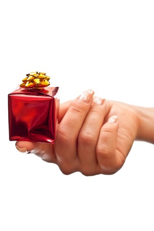 Small red present in woman's hand (finger). Isolated on white Stock Photo - 7942838