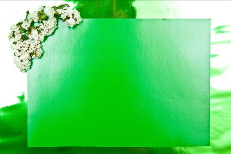Green paper blank with flowers design photo