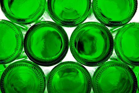 Bottoms of empty glass bottles on white background photo