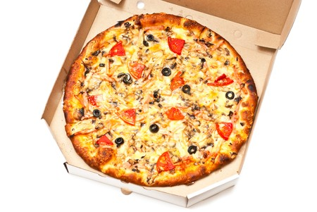 Pizza in open cardboard box isolated on white. Studio shot photo