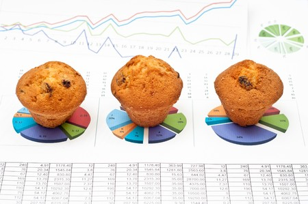 Business still-life with diagrams, charts, numbers and pies photo