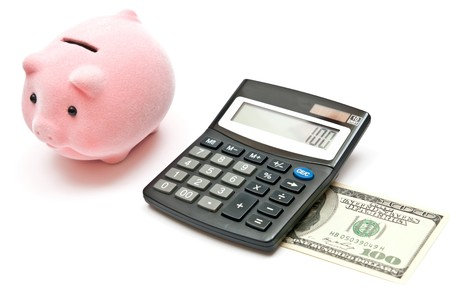 Calculator, piggy bank and 100 dollars. Isolated on white background photo