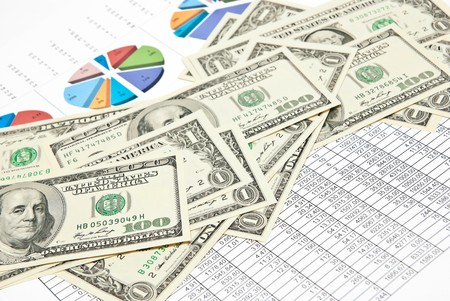 Business still-life with diagrams, charts, numbers and money photo