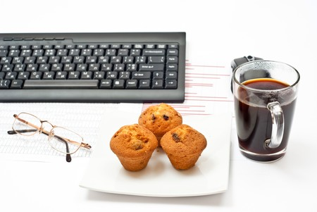 Business still-life with diagrams, glasses, coffee, cakes on plate and keyboard Stock Photo - 7943287