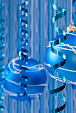 Christmas decoration from two blue balls and ribbons. Focus on ribbon photo