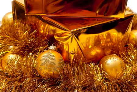 Yellow gifts boxes with christmas balls. White background photo