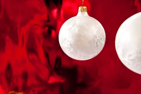 Christmas baubles on red background.Studio shot photo