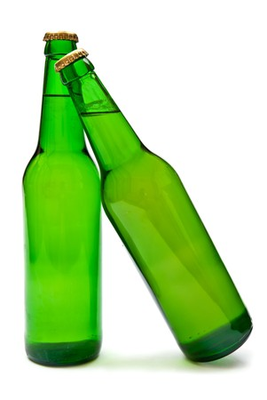 Two cold beers in green bottle isolated on white. Soft shadow photo