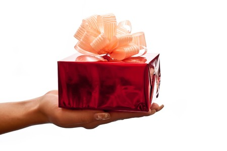 Hand with a red gift box with gold bow isolated on white background Stock Photo - 8152327
