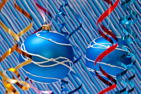 Christmas decoration from two blue balls on blue background photo
