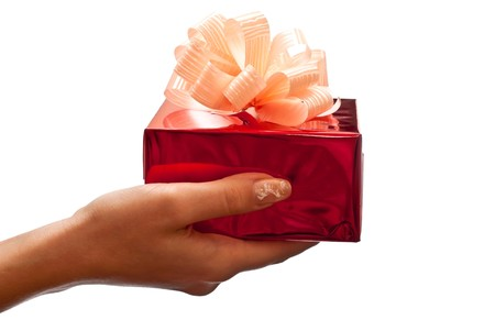 Womans hand with a small red gift box isolated on white background photo