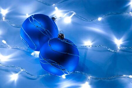 Two blue christmas balls with white garland photo