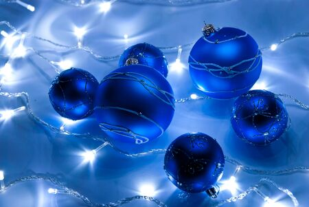 Blue christmas balls with white garland photo