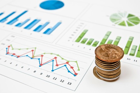 Graphs and charts with stacks of coins Stock Photo - 8152612