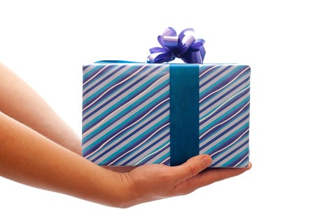 Blue gift box with bow in mans hands. Isolated on white