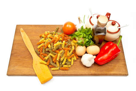 Close-up shot of spaghetti and vegetables on wooden board. Studio shot Stock Photo - 8152754