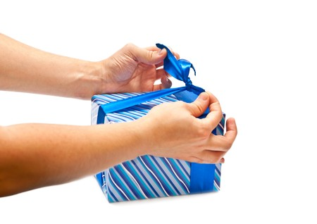 horozontal: Isolated mans hands wrapping blue present. Studio shot Stock Photo