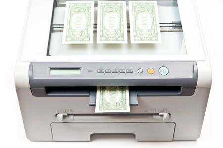 Computer laser printer and dollars isolated on white background photo